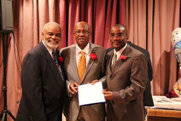"In this In 2012 picture, Matthew Okebiyi receives a ""U.S. Congressional Record of Honor"" award presented to him by Walter Campbell (L) and the Honorable Congressman Edolphus ""Ed"" Towns (C) for his outstanding service to the community."