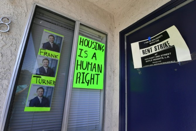 Signs and posters in an apartment block in Boyle Heights, Los Angeles, facing massive rent increases.
