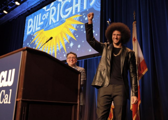 """Colin Kaepernick receives an award at the the ACLU of Southern California's """"Bill of Rights Dinner."""""""